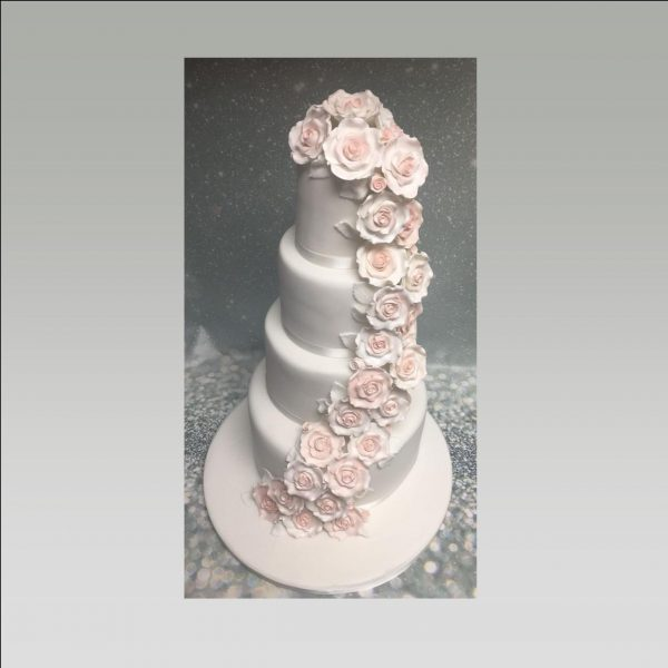 flower cascade wedding cake|rose cascade cake