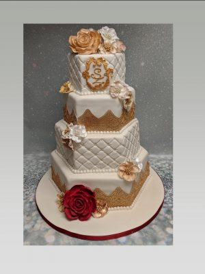 red and gold wedding cake|Indian wedding cake