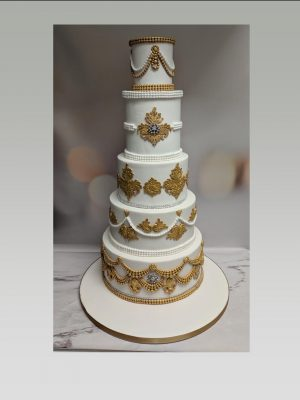 Indian wedding cake|gold wedding cake
